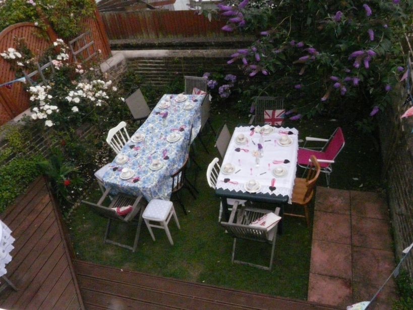 Vintage tea party tables in garden