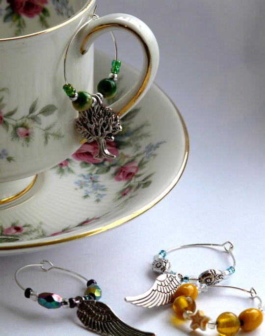 Vintage drink charms on tea cup